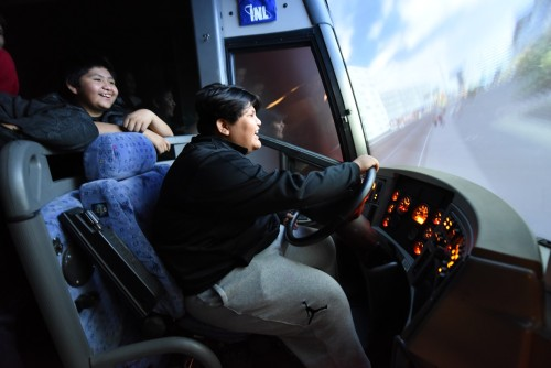 """Students enjoy """"driving"""" the heavy-vehicle simulator in the Advanced Transportation Laboratory where scientists use advanced technology and human psychology to improve heavy-vehicle safety and efficiency."""