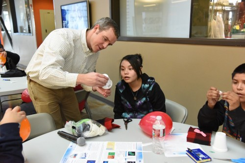 INL scientist Colby Jensen leads students in a hands-on project where they build a simple electroscope to demonstrate the principle of radiation detection.