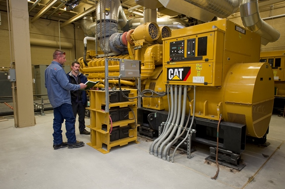 INL project lead Kurt Myers, right, checks the load on emergency diesel generators at Utah's Dugway Proving Ground.
