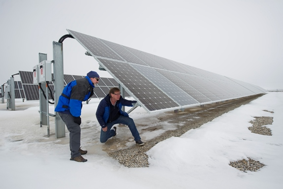 INL researchers Kurt Myers, left, and Robert Turk inspect solar panels at Utah's Dugway Proving Ground.